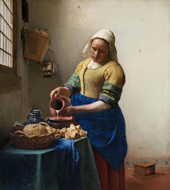 维米尔画作《倒牛奶的佣人》,1685年作,现藏于荷兰阿姆斯特丹国立美术馆。